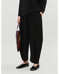 Issey Miyake High-rise Stretch-jersey Tapered Pants - Black