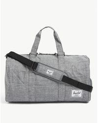 Herschel Supply Co. Novel Branded Woven Duffle Bag - Multicolour