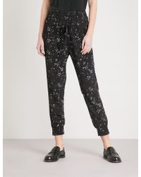 The Kooples - Floral-print Tapered Crepe Trousers - Lyst