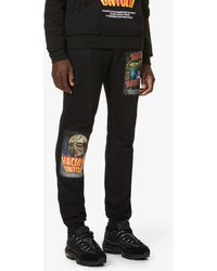 Haculla Poster Tapered Cotton-jersey jogging Bottoms - Black