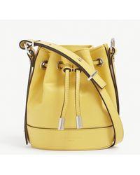 The Kooples Tina Small Brand-embossed Leather Bucket Bag - Yellow