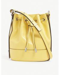 The Kooples Tina Medium Brand-embossed Leather Bucket Bag - Yellow