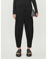 Pleats Please Issey Miyake Basic Tapered-leg High-rise Woven Pants - Black
