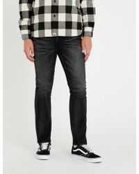 A Bathing Ape - Tiger-embroidered Slim-fit Tapered Jeans - Lyst