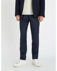 Brunello Cucinelli - Pinstriped Tapered Wool-flannel Trousers - Lyst