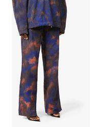 Fenty Tie-dye Print baggy Woven Trousers - Blue