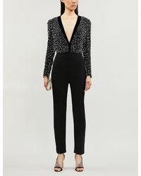 Givenchy Plunge V-neck Relaxed-fit Wool And Silk-blend Jumpsuit - Black