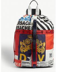 Versace News Print Canvas Duffle Bag - Red