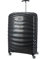 Samsonite - Lite-shock Four-wheel Suitcase 81cm - Lyst