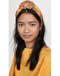 NAMJOSH - Yellow Floral Bun Headband - Lyst