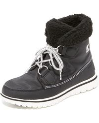 Sorel - Cozy Carnival Women's High Boots In Black - Lyst