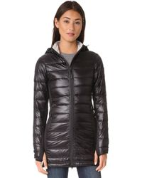 40ff63b963f Hybridge Lite Hooded Coat - Natural ... Info Canada Goose's Hybridge Lite  coat is a sleek cold-weather style. Crafted from lacquered black shell,  it's ...