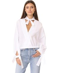Fame & Partners - Surplice Blouse - Lyst