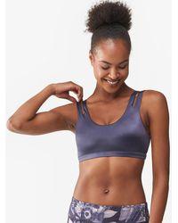 9ff118b46fdc5 Lyst - Nike Indy Shine Bra in Blue