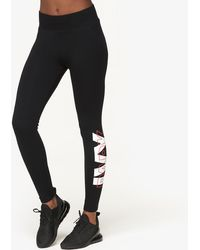 Ivy Park - Layer Logo Ankle Leggings - Lyst