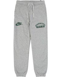 20ce43c4 Nike Stranger Things Hawkins Phys Ed Fleece Pants In Grey Heather/white/fir  in Gray for Men - Lyst
