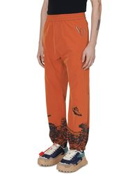Undercover Valentino Space Printed Trousers - Orange