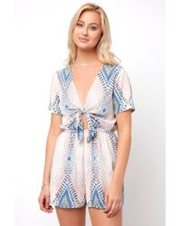 acd9188466cc South Moon Under - Exploded Ikat Knot Front Romper - Lyst