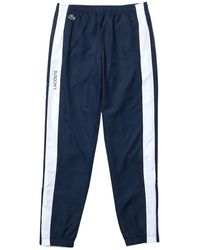 Lacoste Bas de Jogging ref 53172 Marine/Blanc Jogging - Bleu
