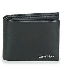 Calvin Klein Geldbeutel MINIMALISM BIFOLD 5CC W/COIN - Schwarz