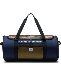 Herschel Supply Co. Bolsa de viaje Sutton Carryall Peacoat/Woodland Camo/Lemon Chrome - Azul