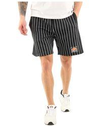 Ellesse - Short Long Stripes hommes Short en Noir - Lyst