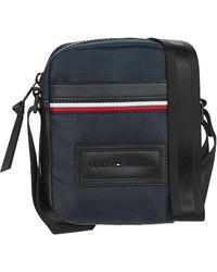 Tommy Hilfiger Handtasje Modern Nylon Mini Reporter - Blauw