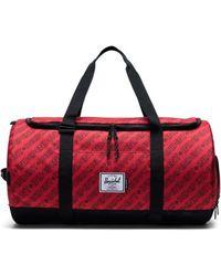 Herschel Supply Co. Reisetasche Sutton Carryall Independent Unified Red/Black Camo - Rot