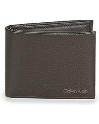 Calvin Klein Geldbeutel WARMTH BIFOLD 5CC W/COIN - Braun