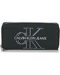 Calvin Klein Geldbeutel ZIP AROUND GLOW - Schwarz