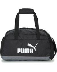 cab9beaefd55 Puma Evopower Medium Wheel Bag Men s Sports Bag In White in White ...