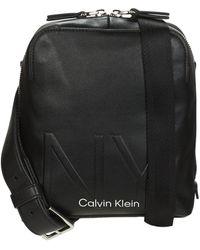 Calvin Klein Shaped Cvrtbl Mini Reporter Pouch - Black