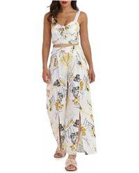 La Modeuse Ensemble pantalon crop top blanc à fleurs Combinaisons