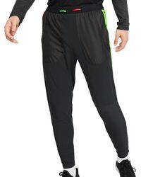 Nike - Trainingsbroek Wild Run Phenom Pant - Lyst
