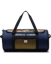 Herschel Supply Co. Reisetasche Sutton Carryall Peacoat/Woodland Camo/Lemon Chrome - Mehrfarbig