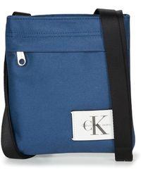 Calvin Klein Jeans - Sport Essential Micro Flatpack M Women's Pouch In Blue - Lyst