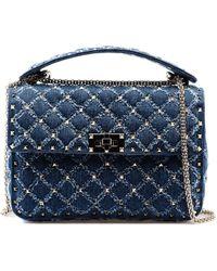 7469ab6afd88 Lyst - Valentino  rockstud Lock  Small Denim Chain Bag in Blue
