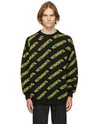 Vetements ブラック & イエロー オールオーバー ロゴ セーター