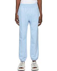 AWAKE NY Pantalon de survêtement bleu à logo exclusif à SSENSE