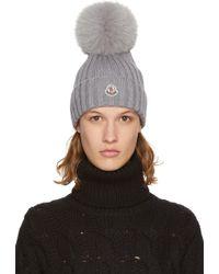 fa1479d39653a1 Moncler | Grey Fur Pom Pom Beanie | Lyst Moncler Grey Fur Pom Pom Beanie  ... Rib knit virgin wool beanie in 'charcoal' grey. Tonal fox fur pom pom  at crown.
