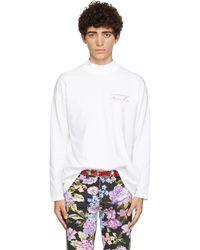 Martine Rose T-shirt à manches longues blanc à logo et col cheminée