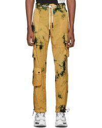 Palm Angels Pantalon cargo a motif tie-dye jaune