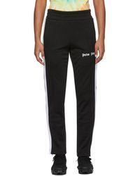 Palm Angels Pantalon de survetement ajuste noir et blanc