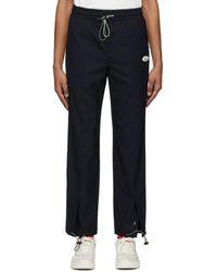 ADER error Pantalon de survetement bleu marine Rivet Label