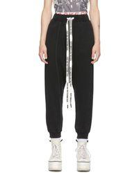 R13 Pantalon de survêtement 'FYYFF' noir torsadé