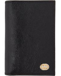 Gucci - Etui pour passeport noir Interlocking G - Lyst