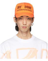 we11done オレンジ ロゴ トラッカー キャップ