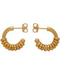 Bottega Veneta Boucles d'oreilles à anneaux dorées - Métallisé