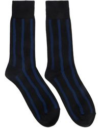 Issey Miyake Chaussettes rayees bleues et noires