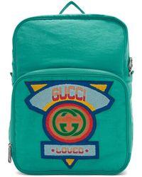 Gucci ブルー ミディアム 80s ロゴ パッチ バックパック